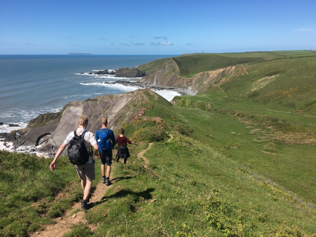 Walking on a steep part of South West Coast Path near Hartland Quay
