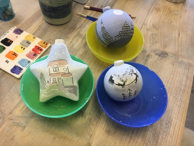 Unglazed painted baubles at Tarka Pottery
