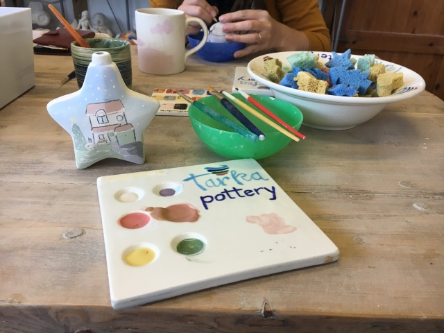 Palette of paint at Tarka Pottery